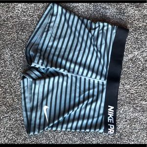 Grey and black striped Nike pro shorts size large.